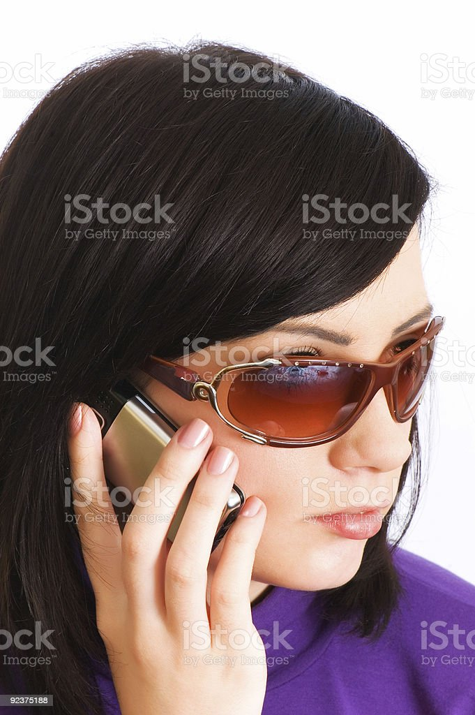Close up of young woman talking on mobile phone royalty-free stock photo