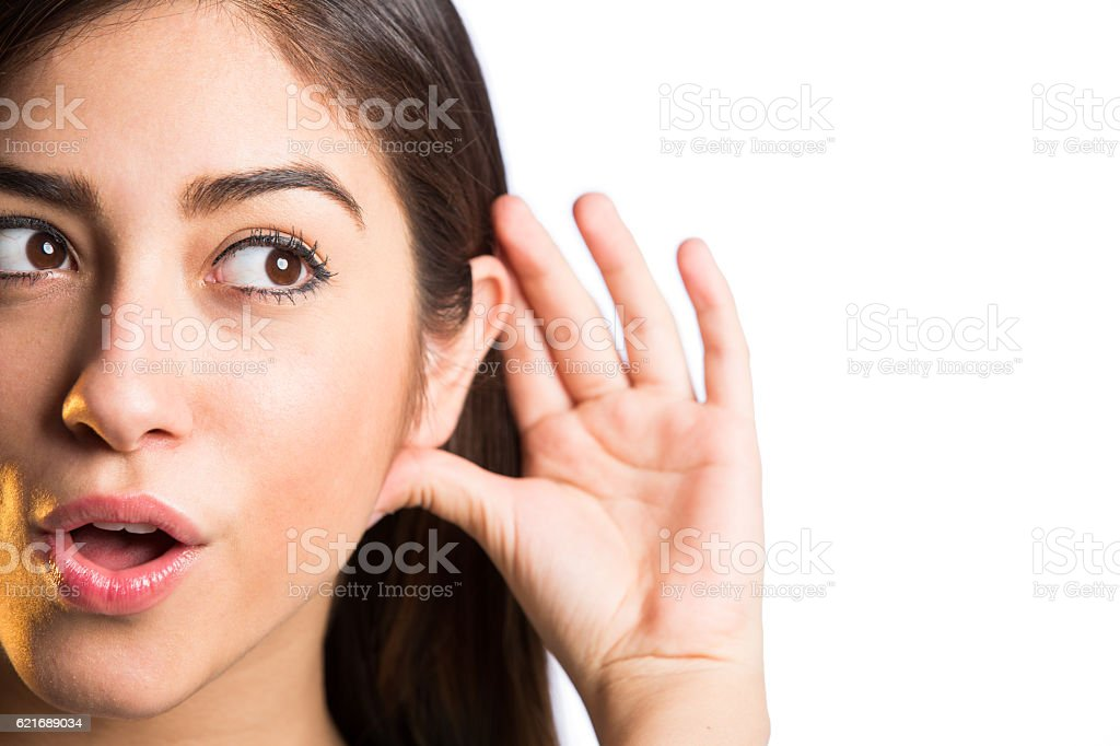 Close up of young woman with hand around ear stock photo