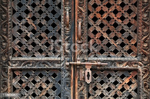 Close up old antique wooden door from Buddhist temple in Kathmandu, Nepal