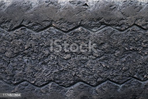 496485590istockphoto close up old damaged and worn black tire tread truck. Tire tread problems and solutions for road safety concept. Change time. transportation. Write text in the texture background and backdrop. 1174822854