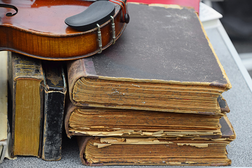 Close up old vintage antique violin and books