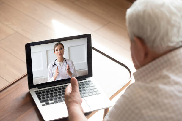 close up older man talking with doctor online, video call - telemedicine stock pictures, royalty-free photos & images