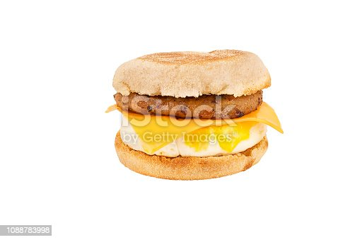 Close up on a sandwich breakfast isolated on white background. English muffin, egg, cheese, lettuce and sausage.