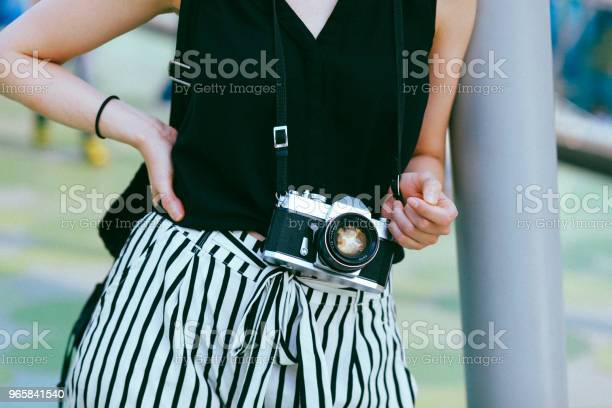 Close Up On A Vintage Film Camera On A Modern Young Woman Stock Photo - Download Image Now