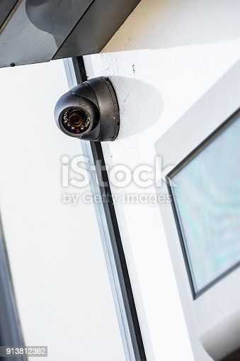 istock close up on a white cctv on a wall near ATM 913812362