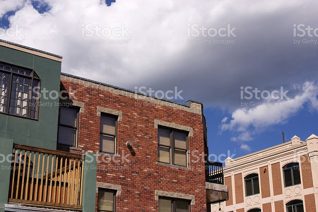 Close up on an Old Building with Cloudy Background stock photo