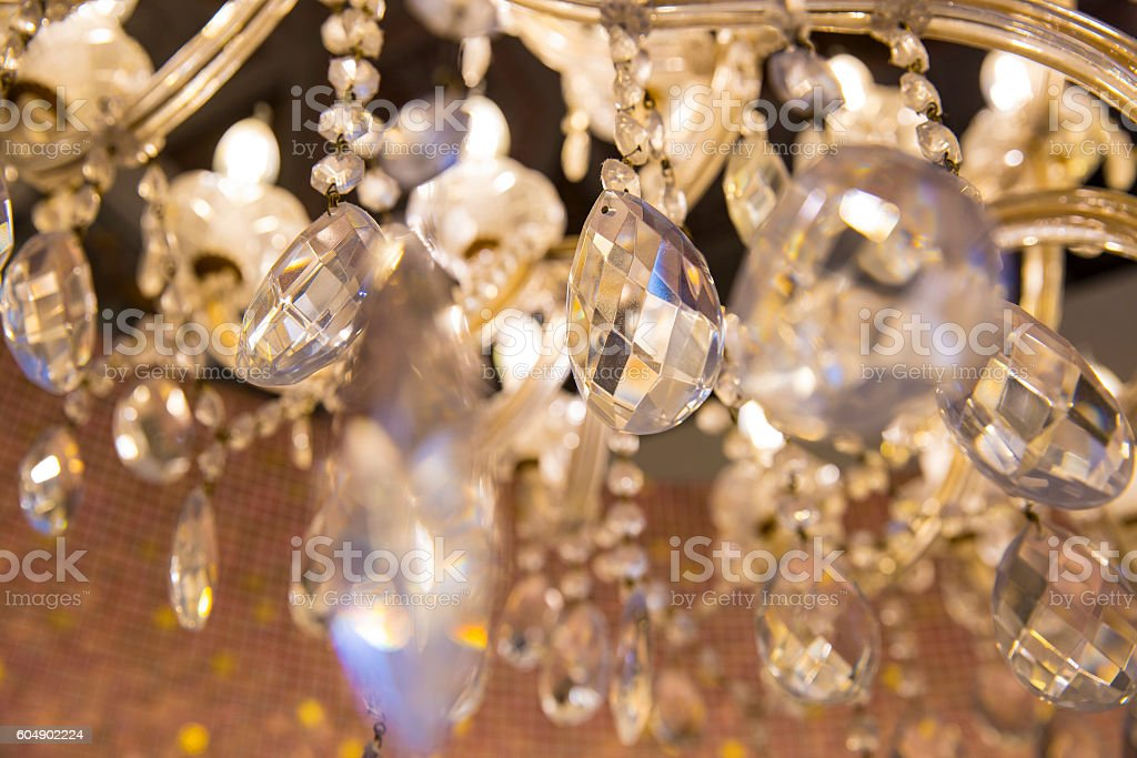 close up on ancient crystal chandelier stock photo
