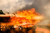 close up on armored tank fire a cannon