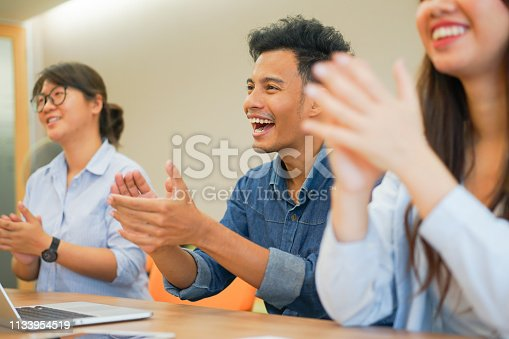 590048454 istock photo close up on asian  businessman and businesswoman hand clapping with team for congratulation of success project in meeting room , business teamwork achievement concept 1133954519