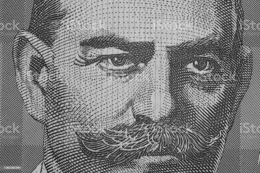 Close up on Australian dollar banknotes. Portrait Black and white of JOHN MONASH on 100AUD Banknotes. Shooting by 1:1 Macro lense.; stock photo