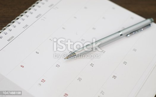 istock close up on ballpoint pen on calendar prepare for write date appointment about work, meeting : office supply for business concept 1047466158