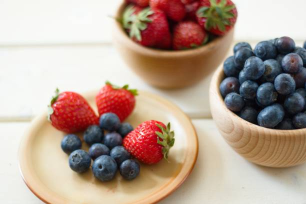 Close up on berries. Strawberries, blueberries stock photo
