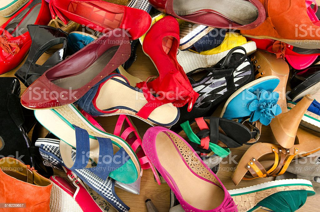 Close up on big pile of colorful woman shoes. stock photo