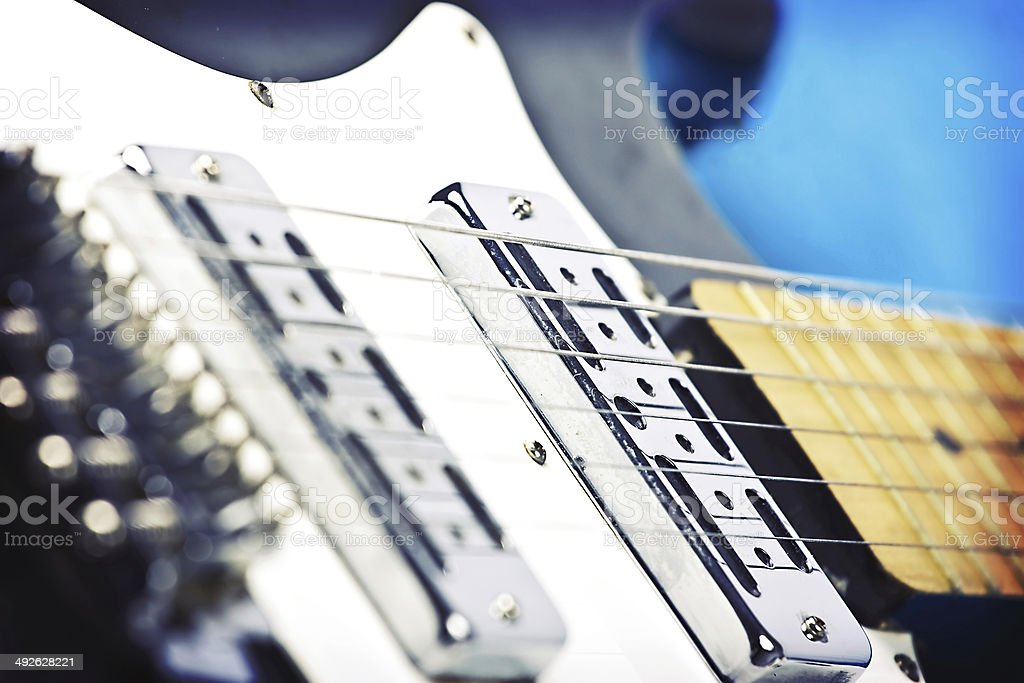 Close up on black and white electric guitar stock photo