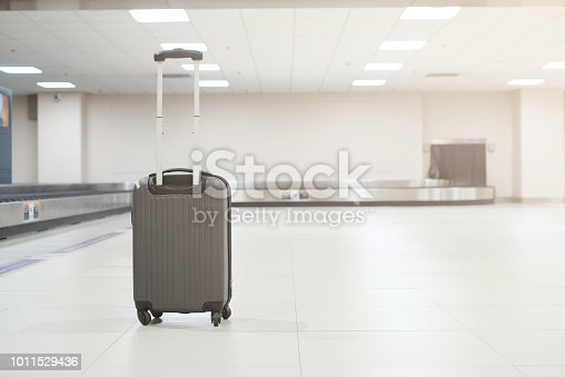 istock close up on black baggage standing at airport terminal after landing,travel concept 1011529436