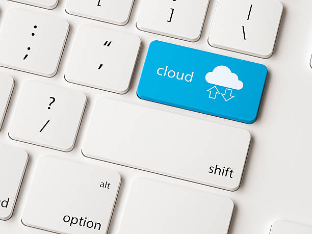 Close up on blue computer keyboard key with cloud. stock photo