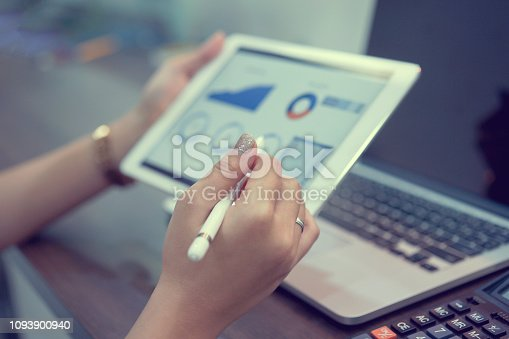 913603748 istock photo close up on businesswoman manager hand using stylus pen for writing or comment on screen dashboard tablet in meeting situation about company's performance , technology and business strategy concept 1093900940