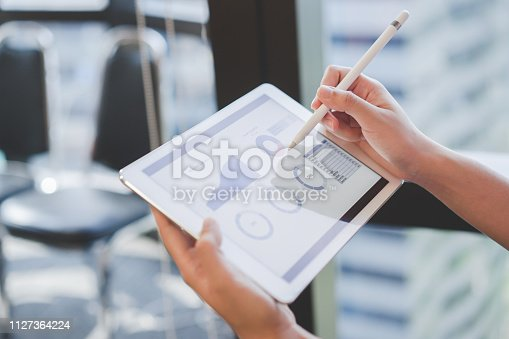 913603748 istock photo close up on businesswoman manager hand using stylus pen for writing or comment on screen dashboard tablet in meeting situation about company's performance , technology and business strategy concept 1127364224