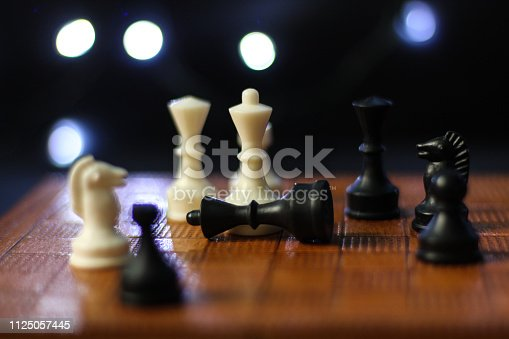 istock Close up on chess board, one chess piece lying down 1125057445