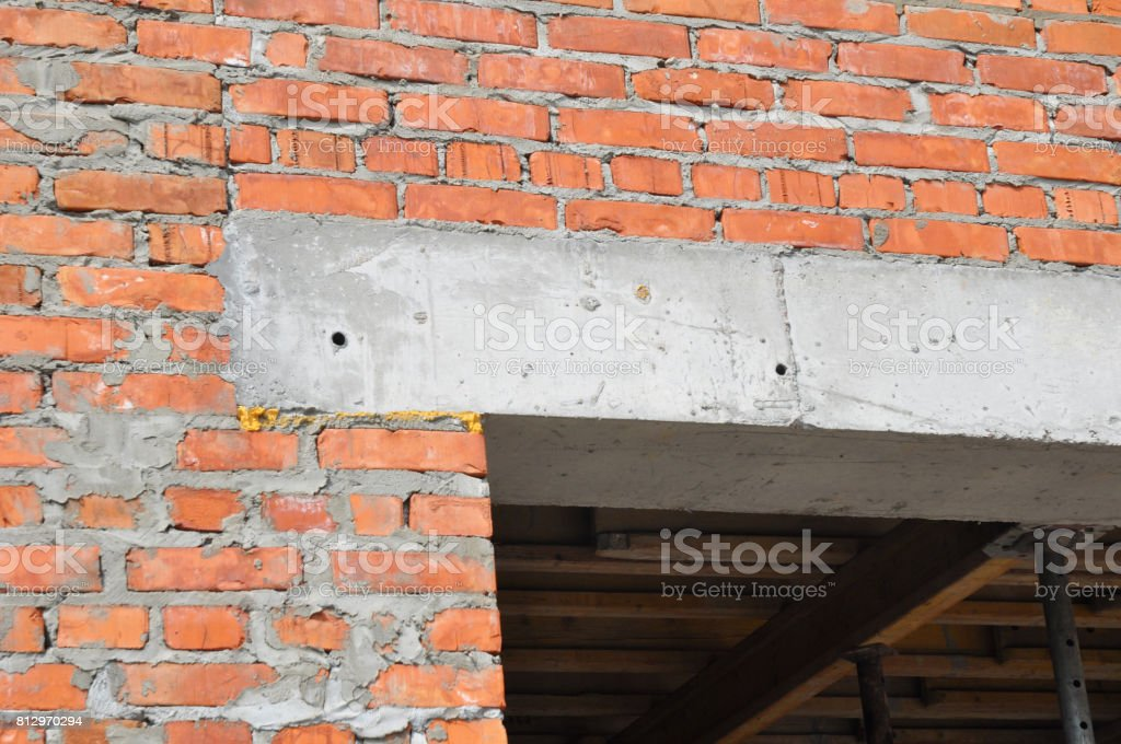 Close up on construction house door concrete lintel on brick house construction. stock photo