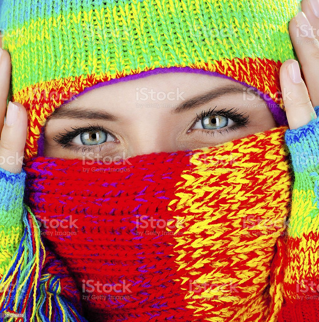 Close up on covered face with blue eyes stock photo