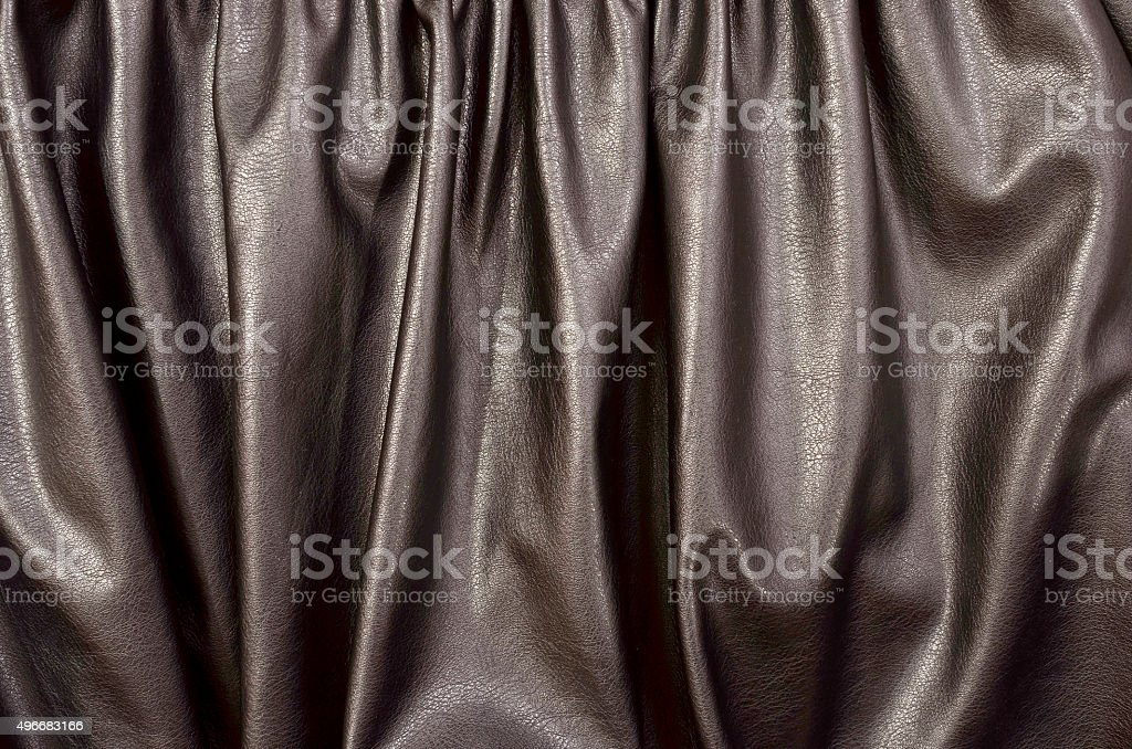 Close up on crumpled black leather material textured fabric. stock photo