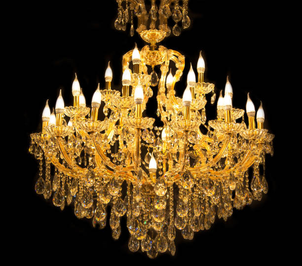 Close up on crystal of contemporary chandelier, Close up on crystal of contemporary chandelier, is a branched ornamental light fixture designed to be mounted on ceilings or walls. Black background chandelier stock pictures, royalty-free photos & images