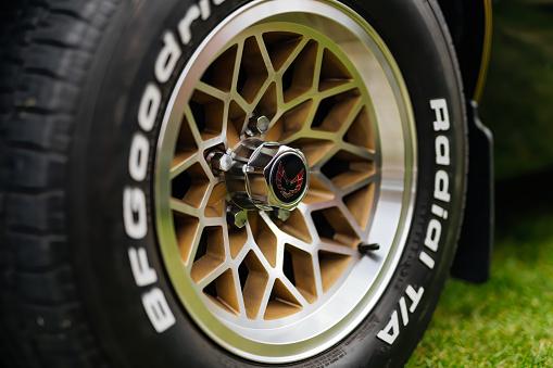 Bray, Ireland, June 2018 Bray Vintage Car Club show with open air retro cars display. Close up on custom alloy wheel of black Pontiac Firebird