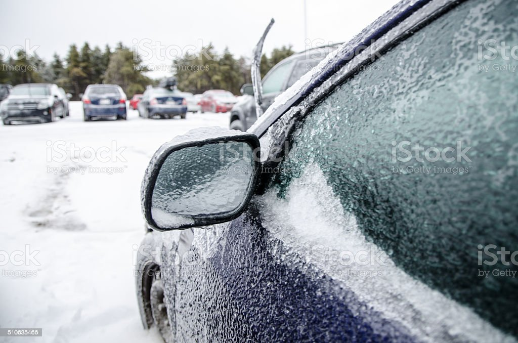 Close up on door of a car after icy rain stock photo