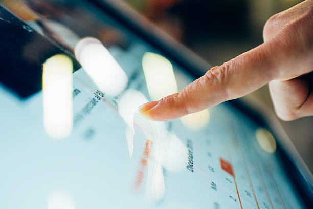 close up on finger touching the screen of a tablet - interactivity stock photos and pictures