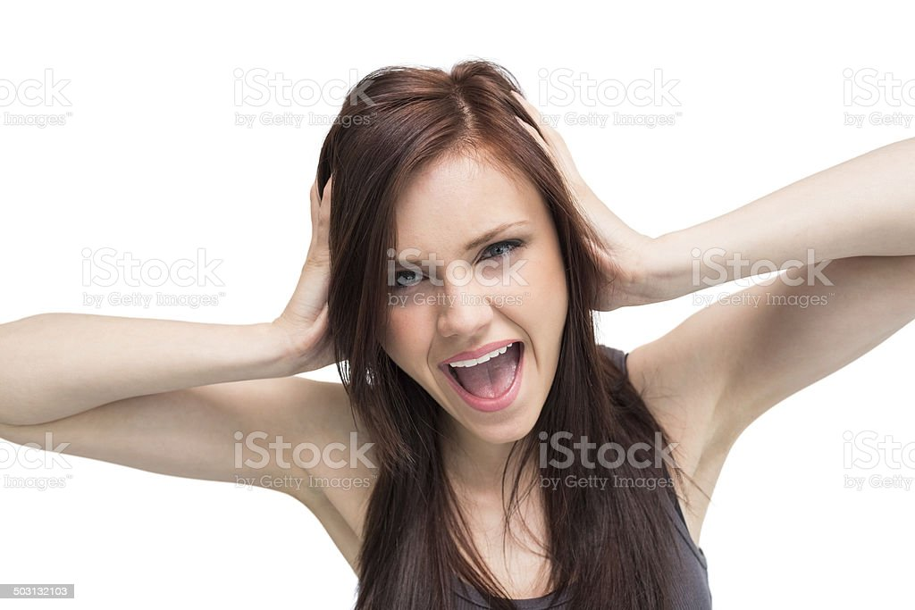 Close up on furious brunette shouting stock photo