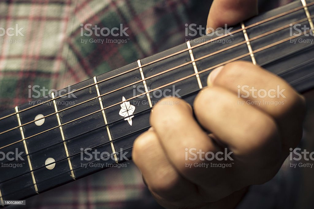 Close up on hand playing guitar royalty-free stock photo