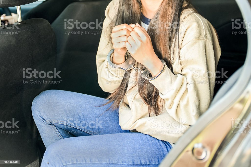 Close up on handcuffed hands of criminal Close up on handcuffed hands of criminal 2015 Stock Photo