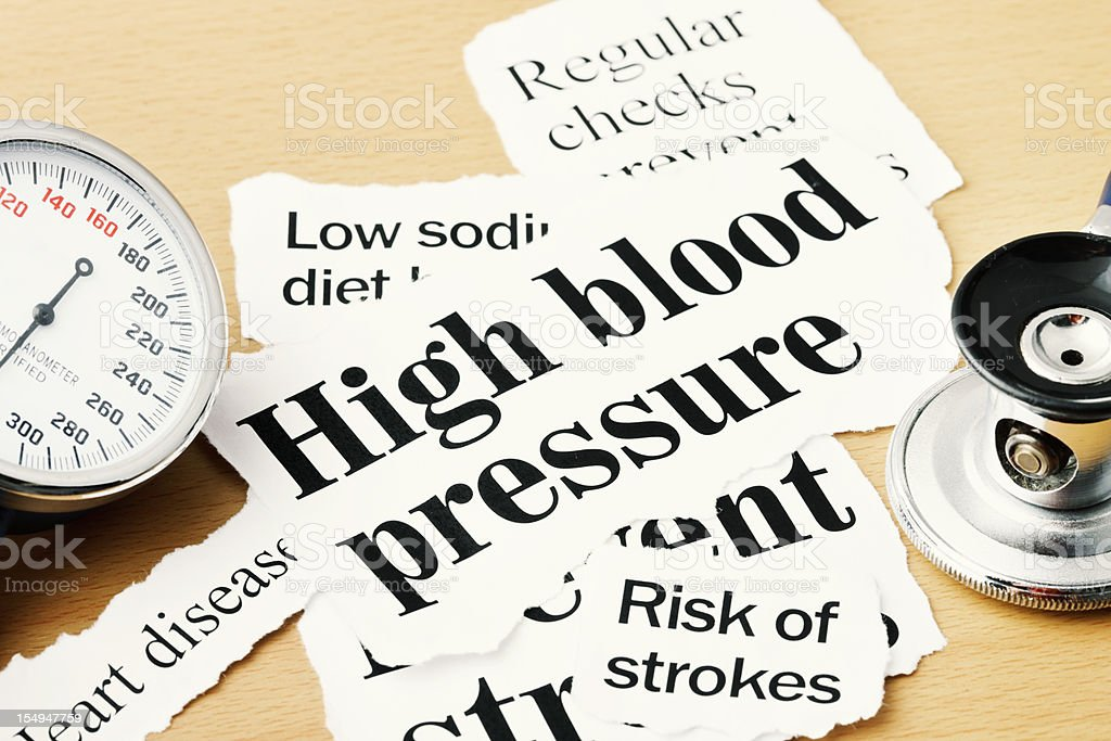 Close up on high blood pressure headlines with medical instruments royalty-free stock photo