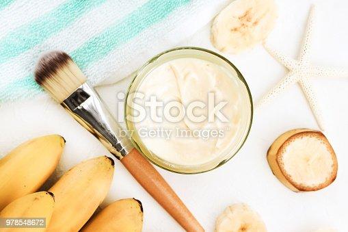Yellow fresh ripe fruit and moisturizer cream, summer replenishing skincare. Light colors.