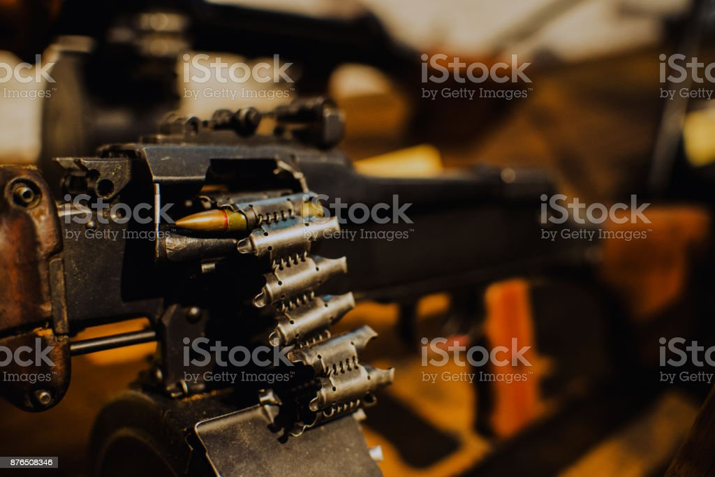 close up on last bullet in the machine gun stock photo