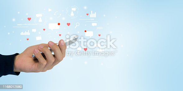 close up on man hand holding smartphone with futuristic of social media marketing icon for internet network technology and business concept
