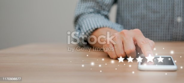 istock close up on man hand pressing on screen smartphone with level five star rating feedback to give good  job (4 star) to provider service concept 1170936577