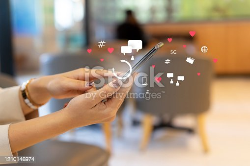 close up on man hand pressing on smartphone to working about futuristic of social media marketing icon for internet network technology and business marketing concept