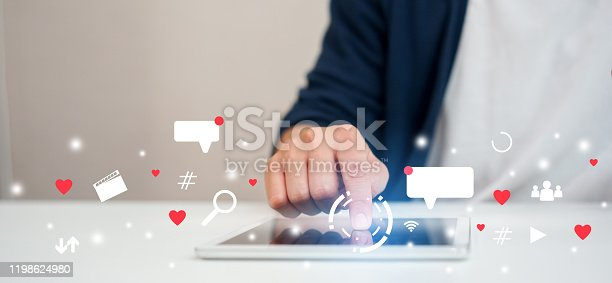 close up on man hand pressing on tablet to working about futuristic of social media marketing icon for internet network technology and business concept
