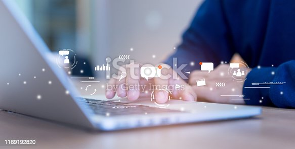 istock close up on man hand using tab pad on laptop to working about futuristic of social media marketing icon for internet network technology and business concept 1169192820