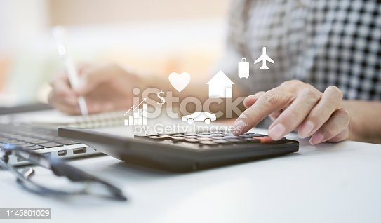close up on mature woman pressing on calculator for making expense monthly and manage spending of life when retire such as home loan,insurance,savings,travel,health , lifestyle aged people concept