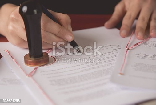 854317150istockphoto Close up on notaries public hand signing the testament 508624258