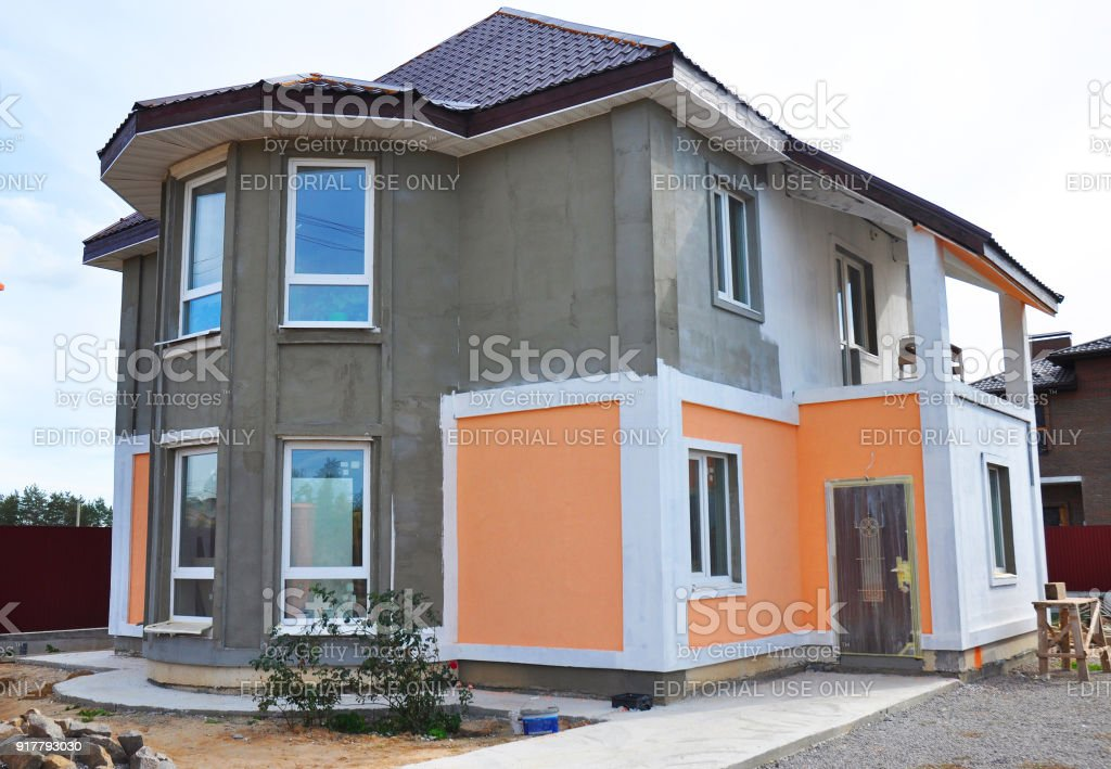 Close Up On Painting And Plastering Exterior House Wall Facade Thermal Insulation And Painting Works During Exterior Renovations Stock Photo Download Image Now Istock