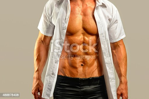 514857923istockphoto Close up on perfect abs, topless strong bodybuilder 488878408