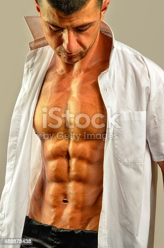 514857923istockphoto Close up on perfect abs, topless strong bodybuilder 488878438