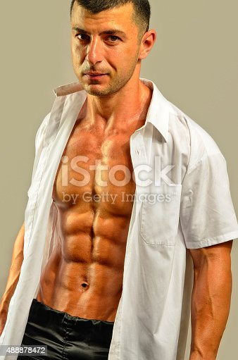 514857923istockphoto Close up on perfect abs, topless strong bodybuilder 488878472