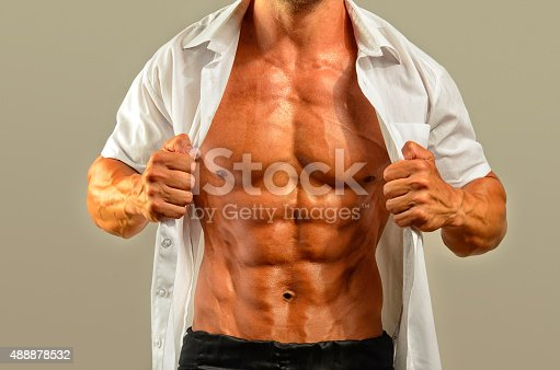 514857923istockphoto Close up on perfect abs, topless strong bodybuilder 488878532