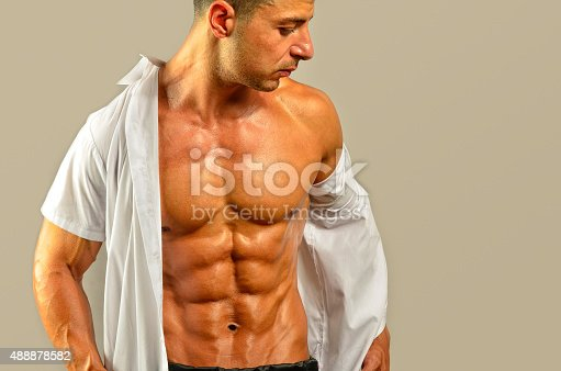 514857923istockphoto Close up on perfect abs, topless strong bodybuilder 488878582