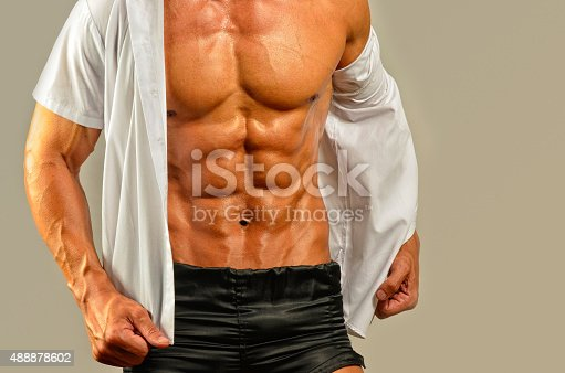 514857923istockphoto Close up on perfect abs, topless strong bodybuilder 488878602